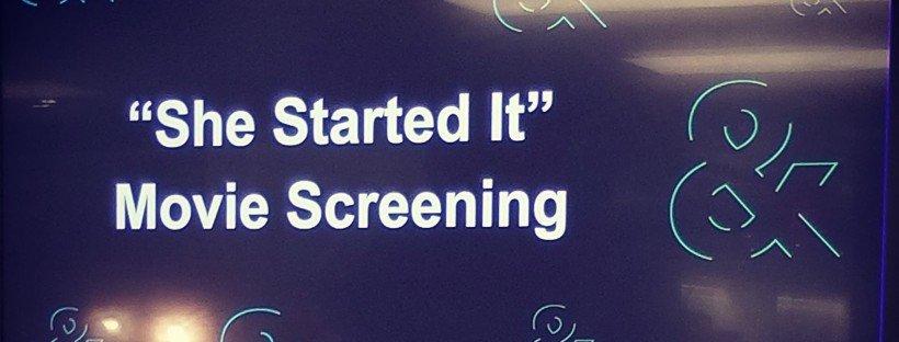 """A photo of a television screen displaying the title, """"'She Started It' – Movie Screening – Diversity & Inclusion at Bloomberg."""""""